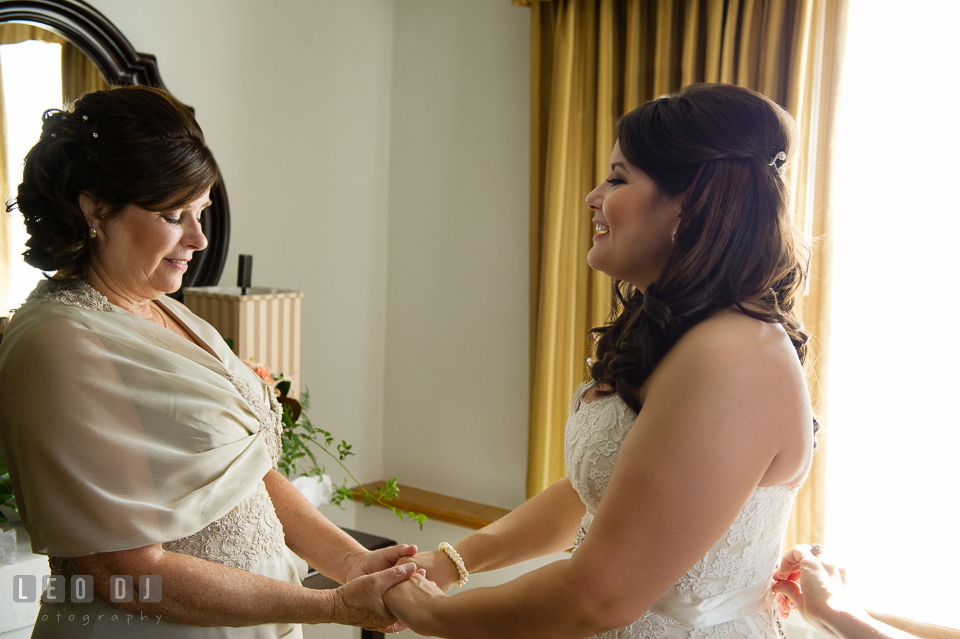 Mother of Bride holding her daughter's hand during the getting ready. The Tidewater Inn wedding, Easton, Eastern Shore, Maryland, by wedding photographers of Leo Dj Photography. http://leodjphoto.com