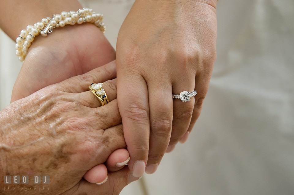 Bride holding her Mother's hand, both showing their beautiful engagement rings. The Tidewater Inn wedding, Easton, Eastern Shore, Maryland, by wedding photographers of Leo Dj Photography. http://leodjphoto.com
