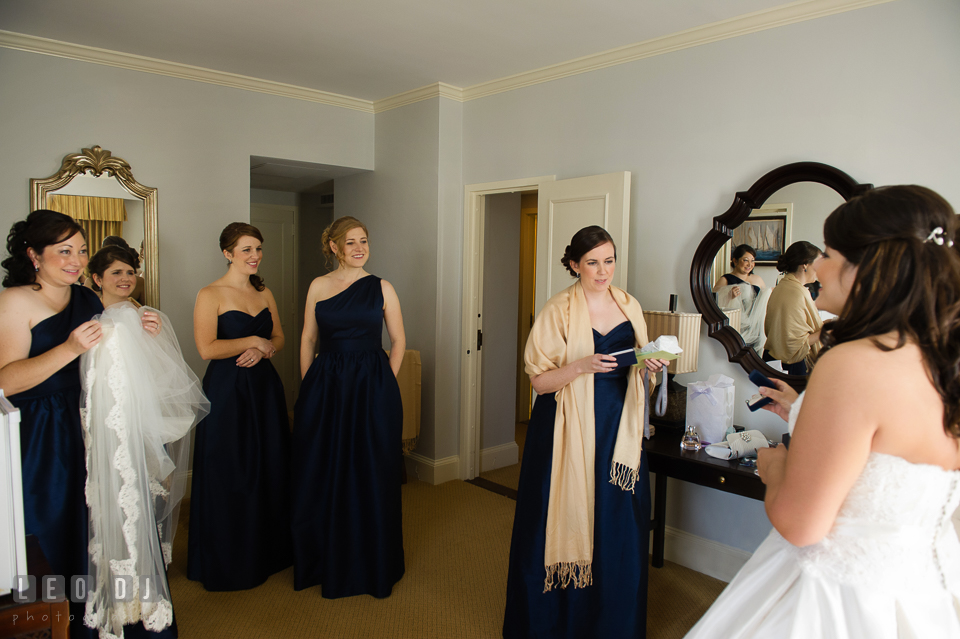 Maid of Honor and the Bridesmaids in awe looking at the Bride in her wedding dress. The Tidewater Inn wedding, Easton, Eastern Shore, Maryland, by wedding photographers of Leo Dj Photography. http://leodjphoto.com