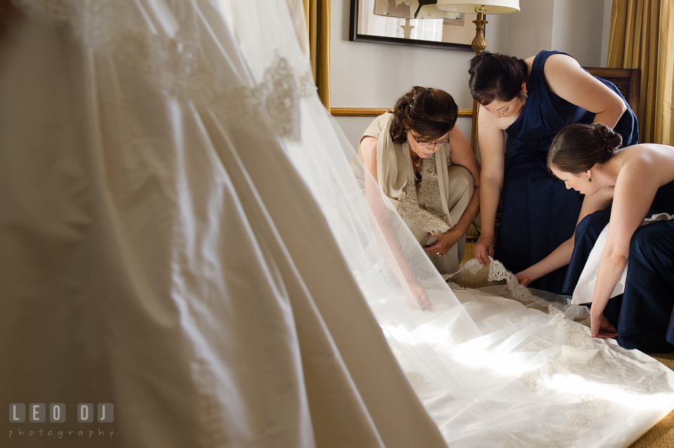 Mother of Bride, Maid of Honor and Bridesmaids arranging the veil. The Tidewater Inn wedding, Easton, Eastern Shore, Maryland, by wedding photographers of Leo Dj Photography. http://leodjphoto.com