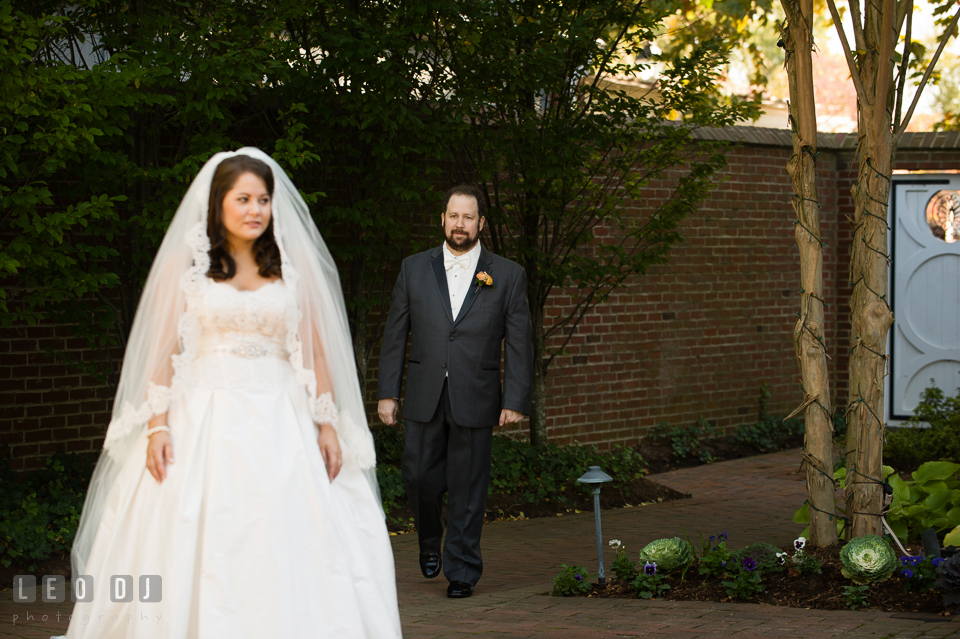 Groom walking toward Bride during their first look before the ceremony. The Tidewater Inn wedding, Easton, Eastern Shore, Maryland, by wedding photographers of Leo Dj Photography. http://leodjphoto.com