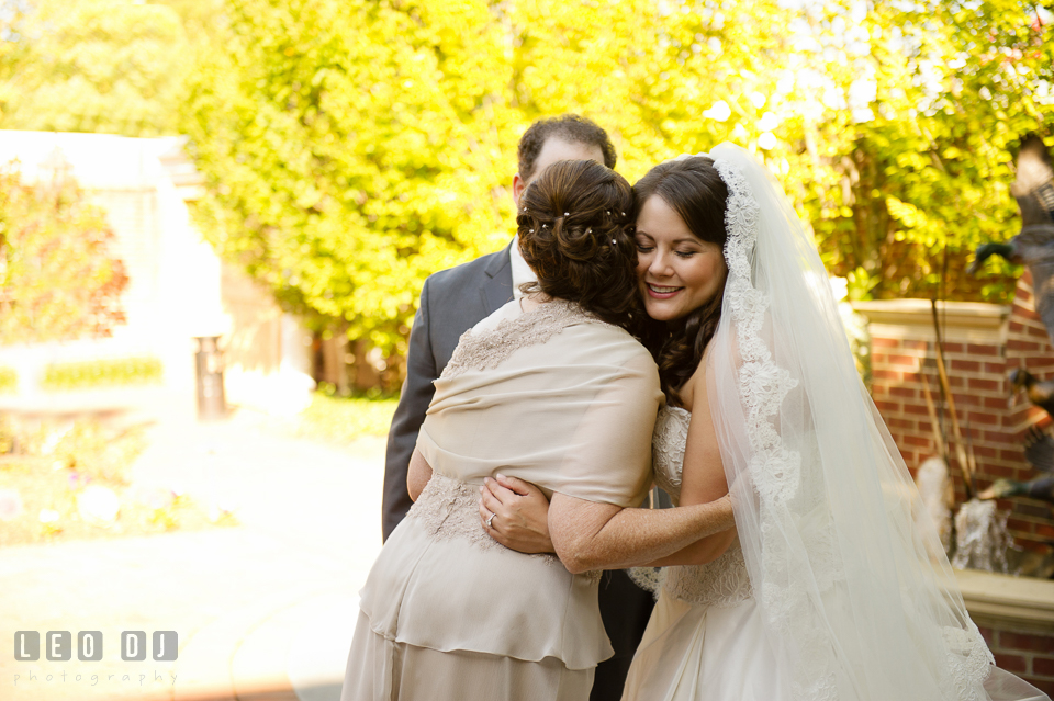 Mother of the Bride hugging her daughter after the first look. The Tidewater Inn wedding, Easton, Eastern Shore, Maryland, by wedding photographers of Leo Dj Photography. http://leodjphoto.com
