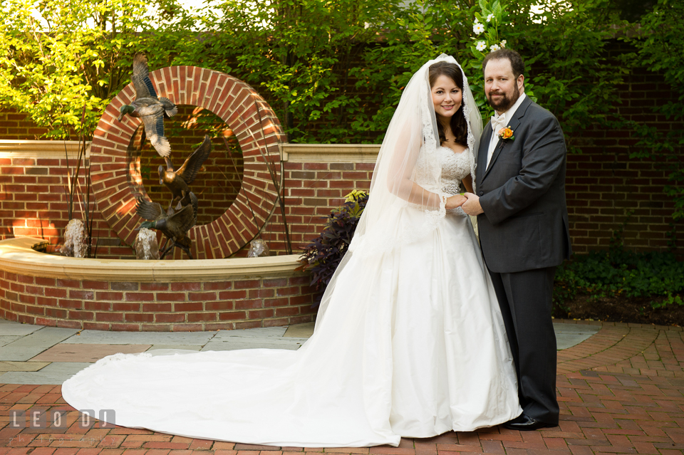 Bride and Groom posing together by the water fountain. The Tidewater Inn wedding, Easton, Eastern Shore, Maryland, by wedding photographers of Leo Dj Photography. http://leodjphoto.com