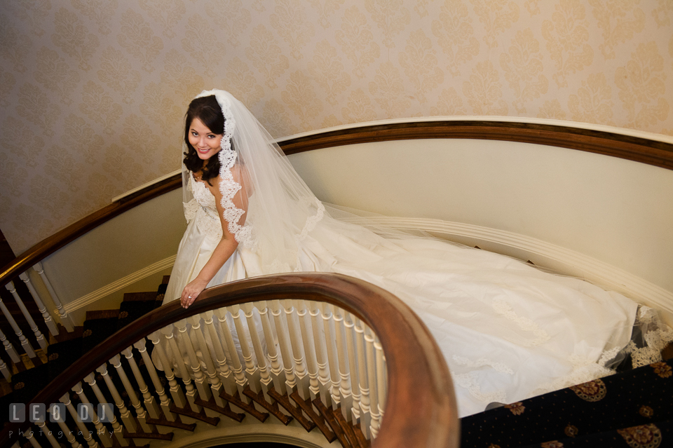 Bride with her long train and cathedral veil walking down the spiral staircase. The Tidewater Inn wedding, Easton, Eastern Shore, Maryland, by wedding photographers of Leo Dj Photography. http://leodjphoto.com