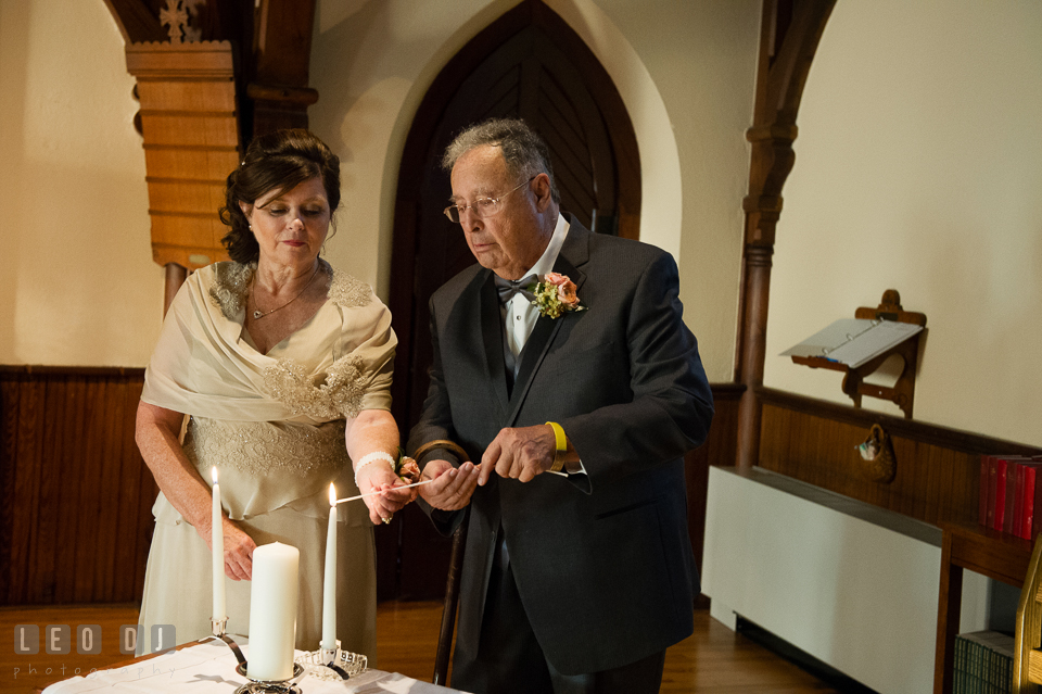 Mother of the Bride and Father of the Groom lighting the unity candles. The Trinity Cathedral wedding, Easton, Eastern Shore, Maryland, by wedding photographers of Leo Dj Photography. http://leodjphoto.com