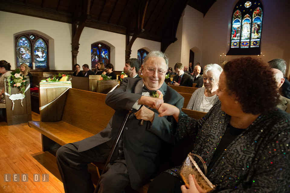 Father of the Groom and his daughter giving fist bump. The Trinity Cathedral wedding, Easton, Eastern Shore, Maryland, by wedding photographers of Leo Dj Photography. http://leodjphoto.com