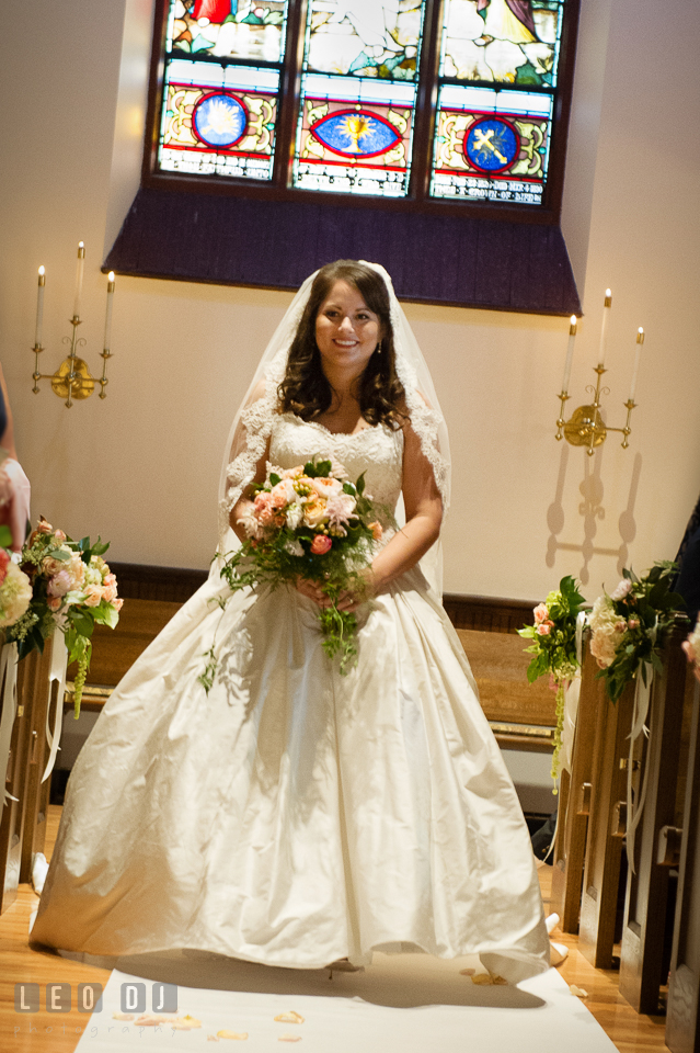 Bride walking down the aisle during the processional. The Trinity Cathedral wedding, Easton, Eastern Shore, Maryland, by wedding photographers of Leo Dj Photography. http://leodjphoto.com