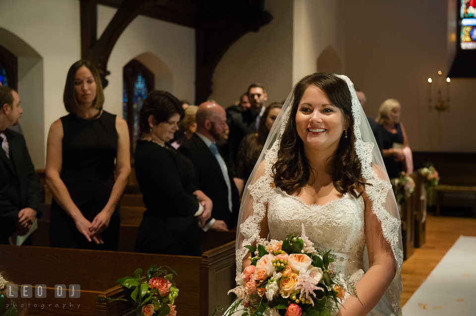 Bride smiling seeing her Groom during the processional. The Trinity Cathedral wedding, Easton, Eastern Shore, Maryland, by wedding photographers of Leo Dj Photography. http://leodjphoto.com