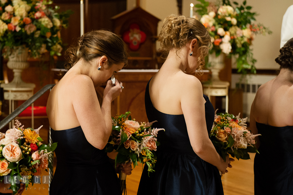 Bridesmaid wiping of her emotional tear during the ceremony. The Trinity Cathedral wedding, Easton, Eastern Shore, Maryland, by wedding photographers of Leo Dj Photography. http://leodjphoto.com