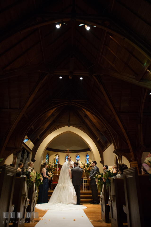 Bride and Groom listening to speech from the church pastor. The Trinity Cathedral wedding, Easton, Eastern Shore, Maryland, by wedding photographers of Leo Dj Photography. http://leodjphoto.com