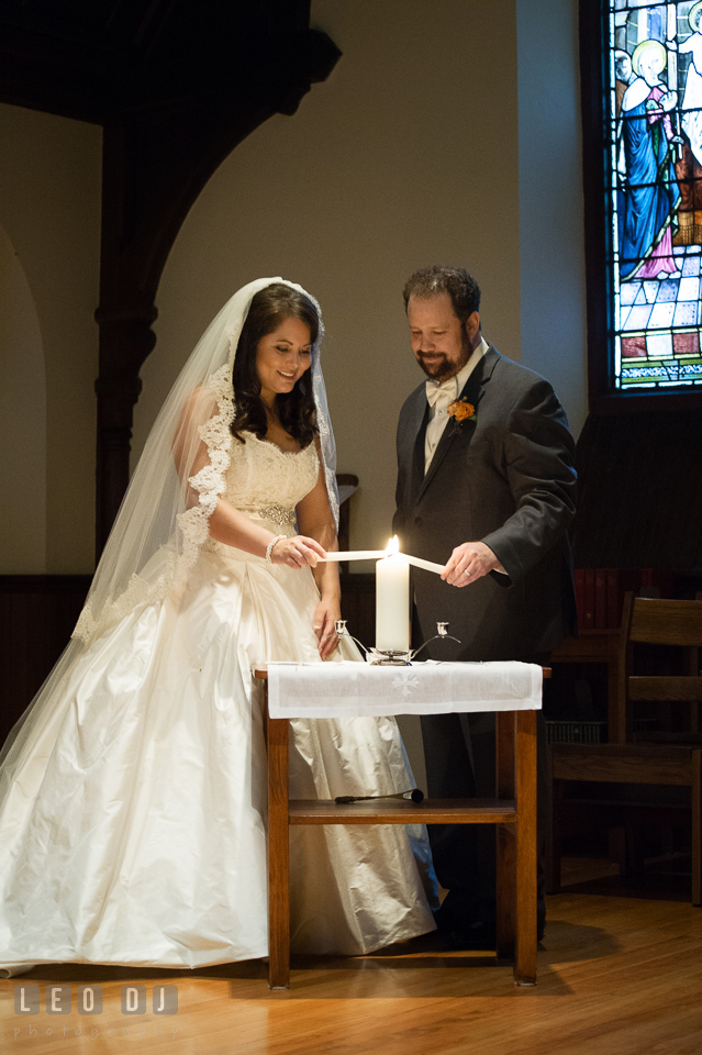 Bride and Groom lighting up the unity candle. The Trinity Cathedral wedding, Easton, Eastern Shore, Maryland, by wedding photographers of Leo Dj Photography. http://leodjphoto.com