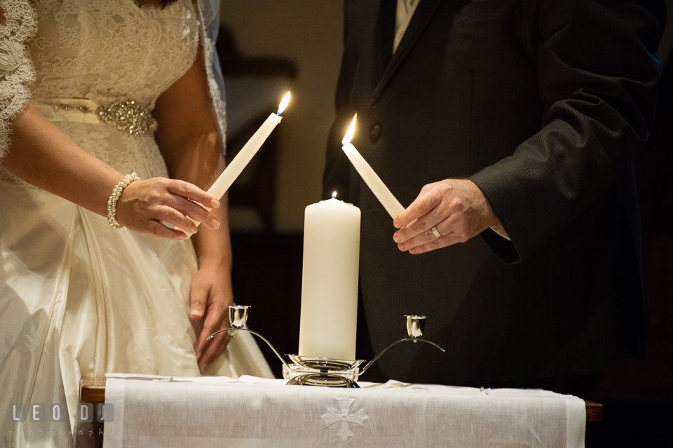 Bride and Groom holding the unity candles. The Trinity Cathedral wedding, Easton, Eastern Shore, Maryland, by wedding photographers of Leo Dj Photography. http://leodjphoto.com