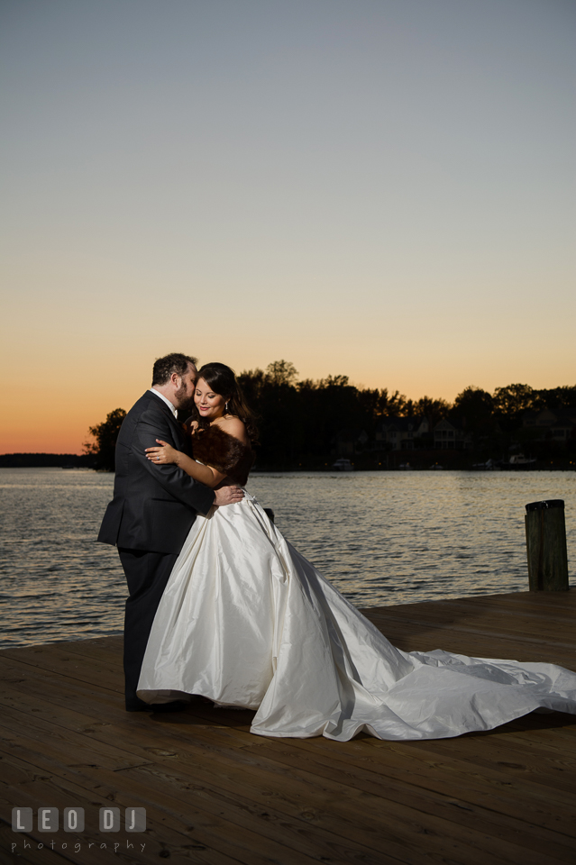 Bride and Groom kissing on the dock during sunset. The Tidewater Inn wedding, Easton, Eastern Shore, Maryland, by wedding photographers of Leo Dj Photography. http://leodjphoto.com