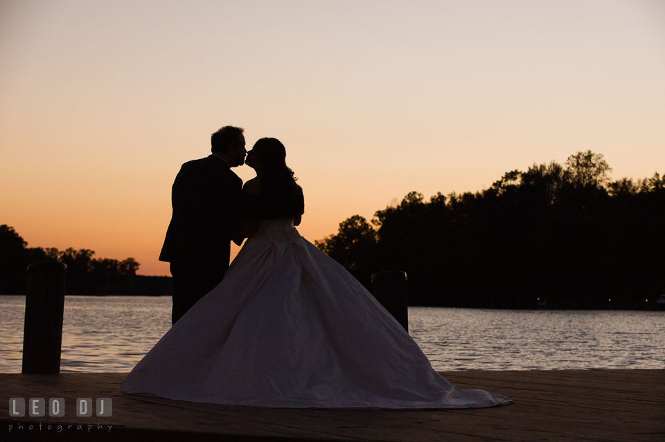 Bride and Groom kissing by the water during sunset. The Tidewater Inn wedding, Easton, Eastern Shore, Maryland, by wedding photographers of Leo Dj Photography. http://leodjphoto.com