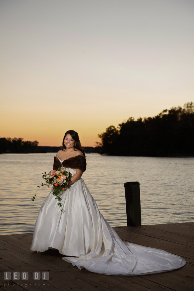 Bride posing with her bouquet by the water during sunset. The Tidewater Inn wedding, Easton, Eastern Shore, Maryland, by wedding photographers of Leo Dj Photography. http://leodjphoto.com