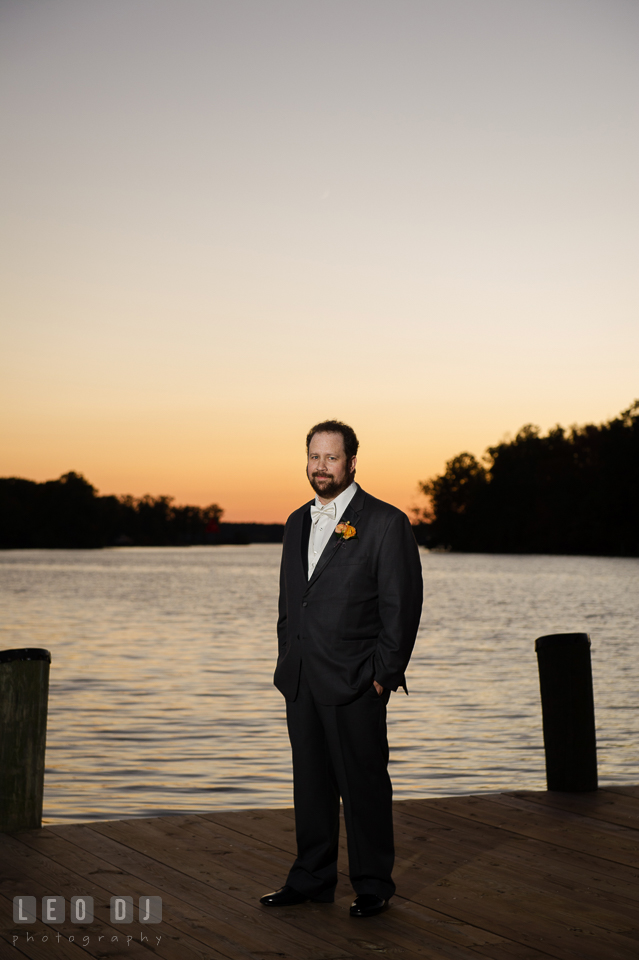Groom posing by the water during sunset. The Tidewater Inn wedding, Easton, Eastern Shore, Maryland, by wedding photographers of Leo Dj Photography. http://leodjphoto.com