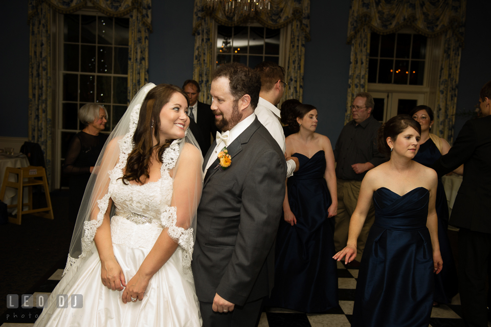 Bride and Groom smiling toward each other during open dance floor. The Tidewater Inn wedding, Easton, Eastern Shore, Maryland, by wedding photographers of Leo Dj Photography. http://leodjphoto.com