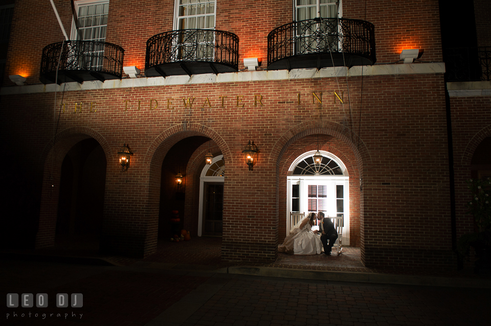 Bride and Groom on the rocking chairs in front of the hotel kissing. The Tidewater Inn wedding, Easton, Eastern Shore, Maryland, by wedding photographers of Leo Dj Photography. http://leodjphoto.com