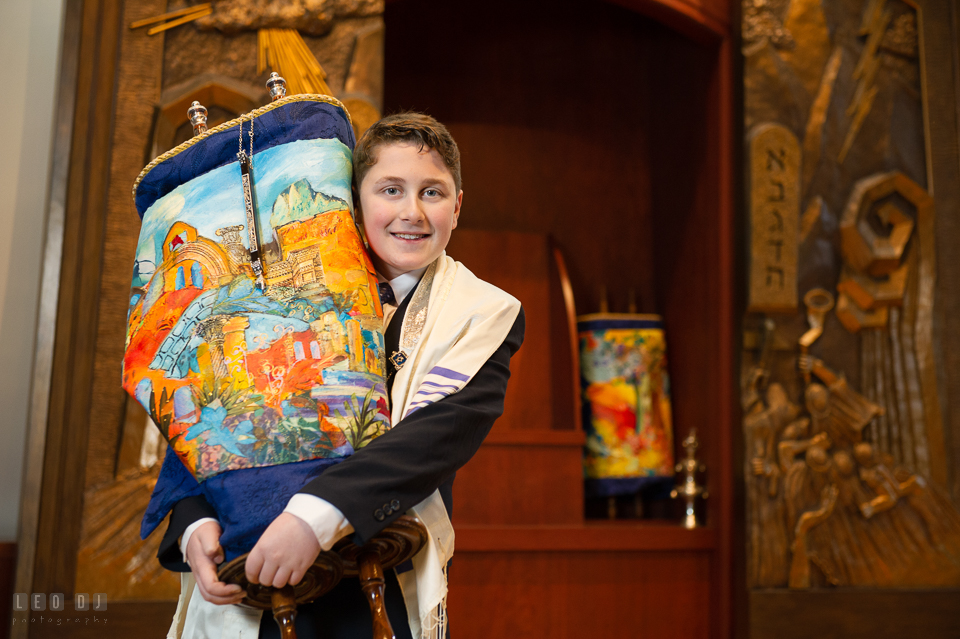 Temple Beth Shalom Annpolis Maryland bar mitzvah boy carrying Torah photo by Leo Dj Photography.