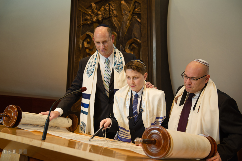 Temple Beth Shalom Annpolis Maryland bar mitzvah boy reading Torah with rabbi and cantor photo by Leo Dj Photography.