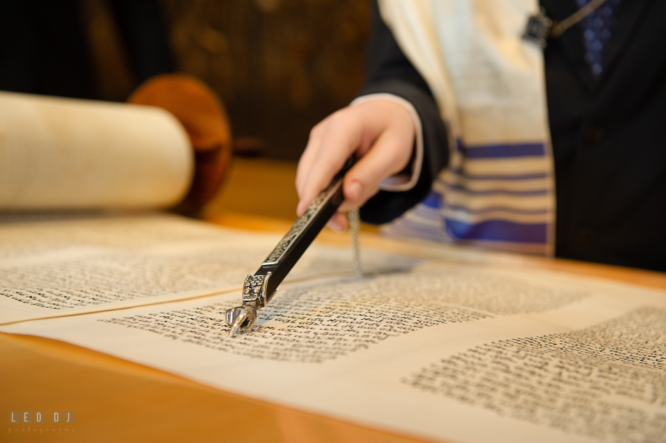 Temple Beth Shalom Annpolis Maryland bar mitzvah boy using yad or Torah pointer to read the parchment Torah scrolls photo by Leo Dj Photography.
