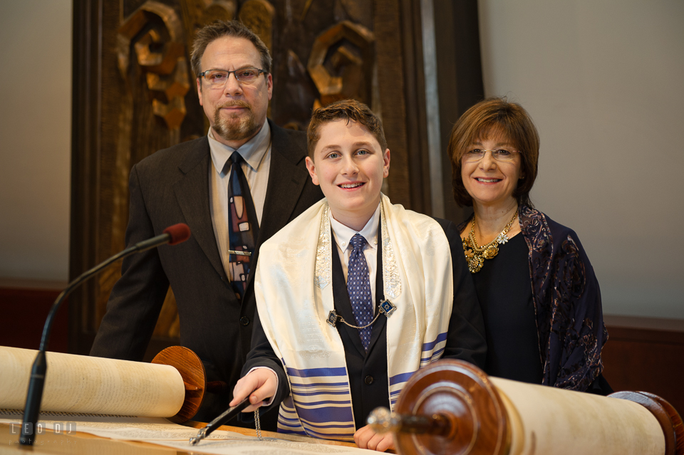 Temple Beth Shalom Annpolis Maryland bar mitzvah boy posing with Mother and Father by Torah photo by Leo Dj Photography.