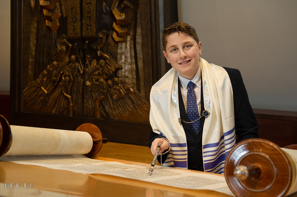 Temple Beth Shalom Annpolis Maryland bar mitzvah boy posing while reading Torah photo by Leo Dj Photography.