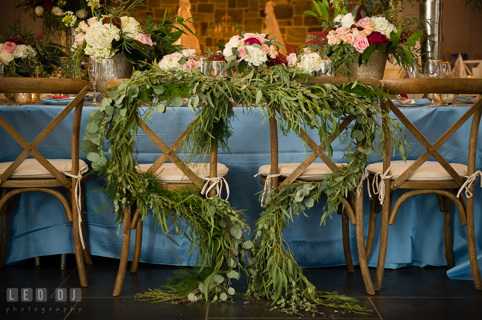 Heart shaped foliage for the dinning table and chairs designed by Lauren Niles Events and flowers from florist Little House of Flowers. Kent Island Maryland Chesapeake Bay Beach Club Bow Ties and Bubbly wedding show photos at the Breezeway, by wedding photographers of Leo Dj Photography. http://leodjphoto.com