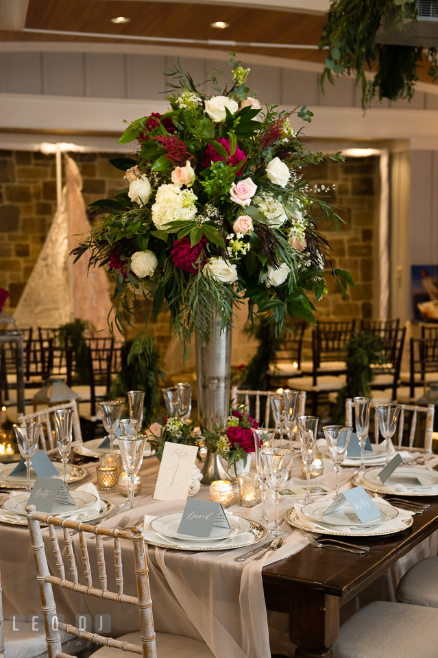 Table setup with tall centerpiece designed by Lauren Niles Events and flowers from florist Little House of Flowers. Kent Island Maryland Chesapeake Bay Beach Club Bow Ties and Bubbly wedding show photos at the Breezeway, by wedding photographers of Leo Dj Photography. http://leodjphoto.com
