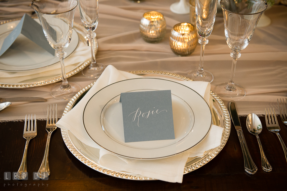 Silver and white plate setting with card calligraphy from Poppy & Scooter. Kent Island Maryland Chesapeake Bay Beach Club Bow Ties and Bubbly wedding show photos at the Breezeway, by wedding photographers of Leo Dj Photography. http://leodjphoto.com
