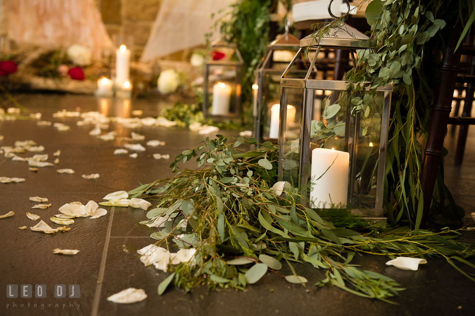 Lanterns, candles and foliage for ceremony aisle design by Lauren Niles Events, florist Little House of Flowers, and 2hands Studios rentals. Kent Island Maryland Chesapeake Bay Beach Club Bow Ties and Bubbly wedding show photos at the Breezeway, by wedding photographers of Leo Dj Photography. http://leodjphoto.com