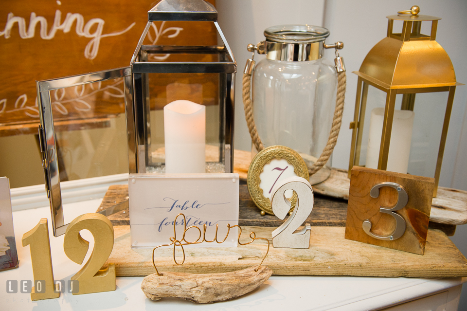 Table numbers and lanterns rental by 2hands Studios. Kent Island Maryland Chesapeake Bay Beach Club Bow Ties and Bubbly wedding show photos at the Breezeway, by wedding photographers of Leo Dj Photography. http://leodjphoto.com