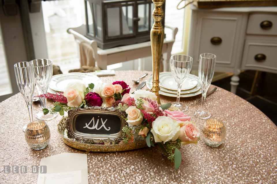 Sequined table linen, table number from 2hands Studios. Kent Island Maryland Chesapeake Bay Beach Club Bow Ties and Bubbly wedding show photos at the Breezeway, by wedding photographers of Leo Dj Photography. http://leodjphoto.com