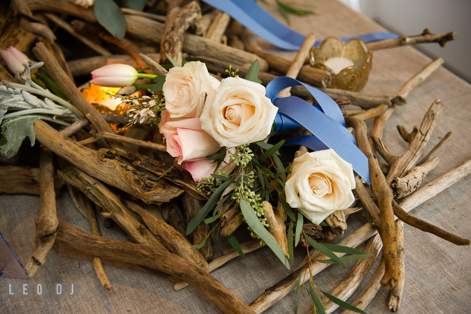 White roses and driftwood design by florist Little House of Flowers. Kent Island Maryland Chesapeake Bay Beach Club Bow Ties and Bubbly wedding show photos at the Breezeway, by wedding photographers of Leo Dj Photography. http://leodjphoto.com