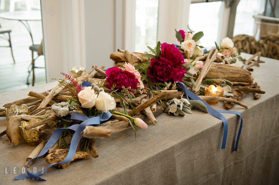 Red ponies, white roses, blue ribbons, and driftwood design by florist Little House of Flowers. Kent Island Maryland Chesapeake Bay Beach Club Bow Ties and Bubbly wedding show photos at the Breezeway, by wedding photographers of Leo Dj Photography. http://leodjphoto.com