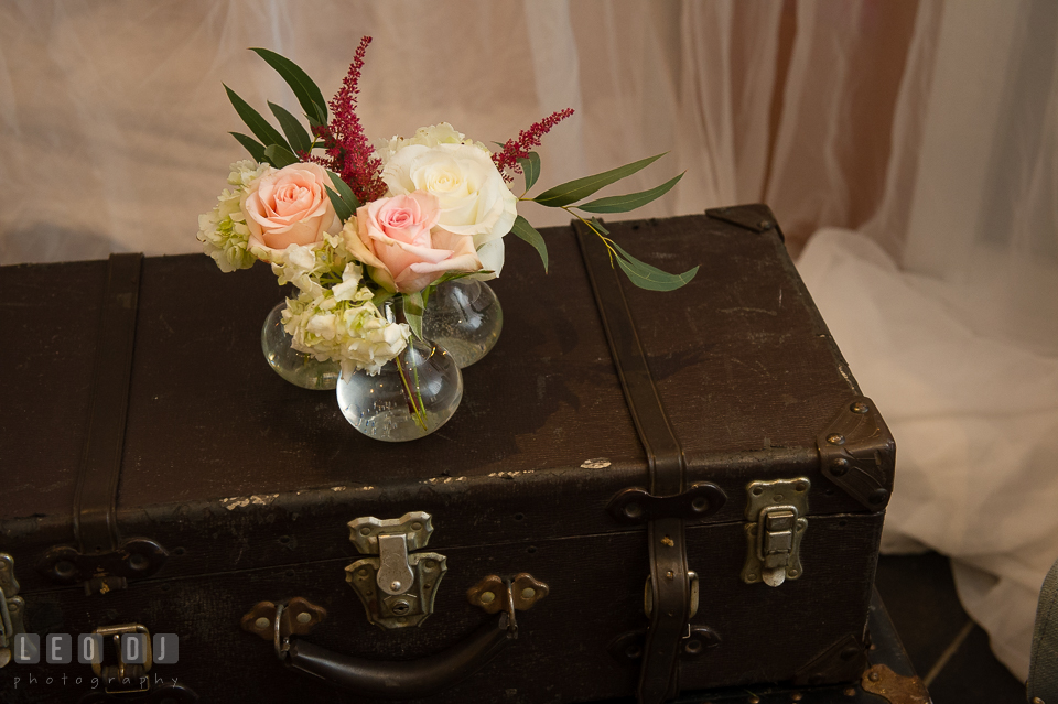 Decor design using vintage suitcase from 2hands Studios and flowers from Little House of Flowers. Kent Island Maryland Chesapeake Bay Beach Club Bow Ties and Bubbly wedding show photos at the Breezeway, by wedding photographers of Leo Dj Photography. http://leodjphoto.com