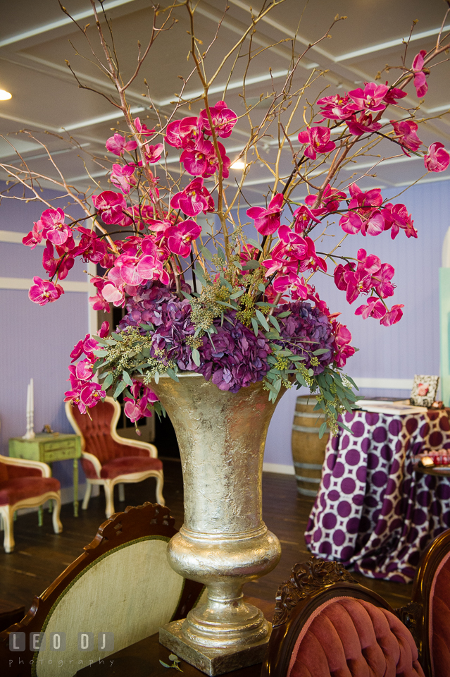 Red purple orchid flowers on golden vase from Wicked Willow. Kent Island Maryland Chesapeake Bay Beach Club Bow Ties and Bubbly wedding show photos at the Tavern Bayside, by wedding photographers of Leo Dj Photography. http://leodjphoto.com