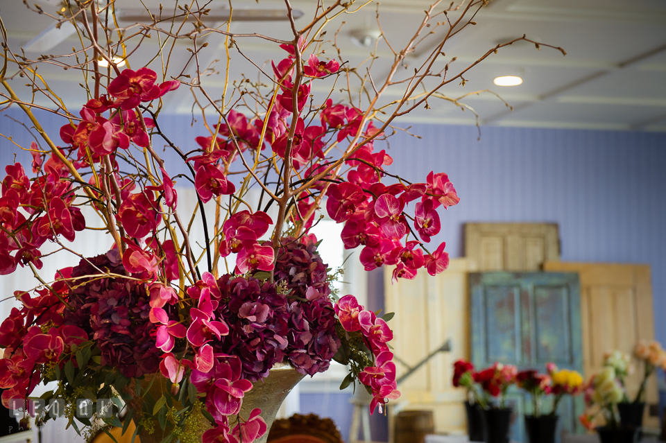 Red and purple orchid from Wicked Willow with old doors from Vintage Affairs. Kent Island Maryland Chesapeake Bay Beach Club Bow Ties and Bubbly wedding show photos at the Tavern Bayside, by wedding photographers of Leo Dj Photography. http://leodjphoto.com