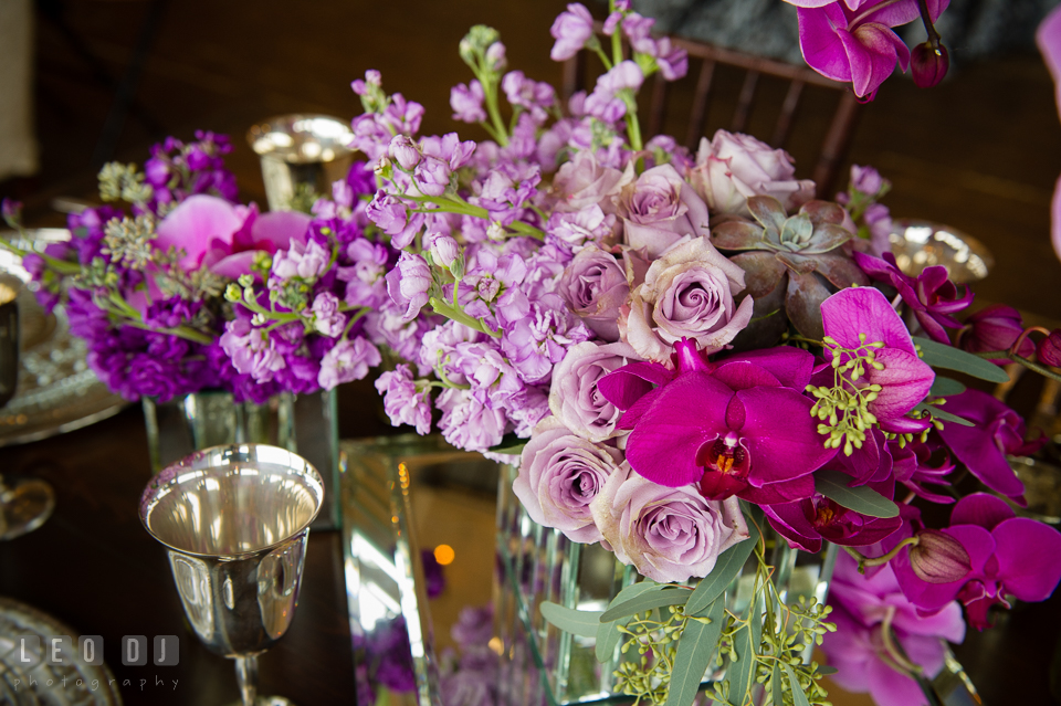 Purple flowers and orchids for table centerpiece from florist Wicked Willow. Kent Island Maryland Chesapeake Bay Beach Club Bow Ties and Bubbly wedding show photos at the Tavern Bayside, by wedding photographers of Leo Dj Photography. http://leodjphoto.com