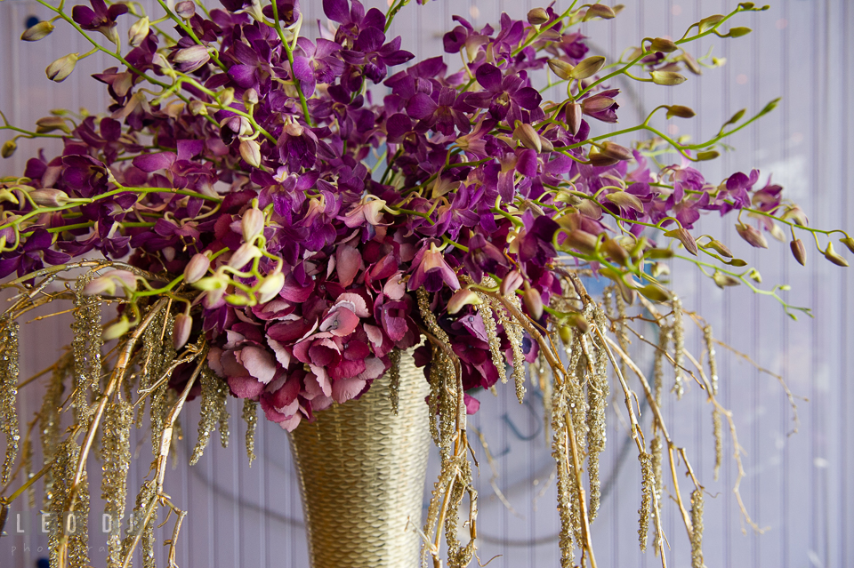 Close up of purple orchid and red purple hydrangea from florist Wicked Willow. Kent Island Maryland Chesapeake Bay Beach Club Bow Ties and Bubbly wedding show photos at the Tavern Bayside, by wedding photographers of Leo Dj Photography. http://leodjphoto.com