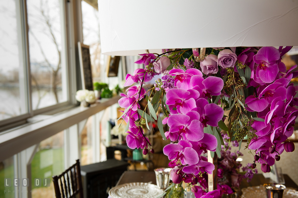 Hanging purple orchid and roses table centerpiece from florist Wicked Willow. Kent Island Maryland Chesapeake Bay Beach Club Bow Ties and Bubbly wedding show photos at the Tavern Bayside, by wedding photographers of Leo Dj Photography. http://leodjphoto.com