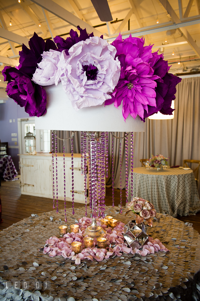 Large violet and purple paper flowers from florist Wicked Willow on old table lamp from Vintage Affairs. Kent Island Maryland Chesapeake Bay Beach Club Bow Ties and Bubbly wedding show photos at the Tavern Bayside, by wedding photographers of Leo Dj Photography. http://leodjphoto.com