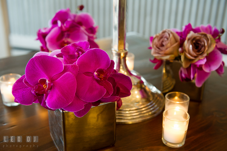 Large purple orchids and candles. Kent Island Maryland Chesapeake Bay Beach Club Bow Ties and Bubbly wedding show photos at the Tavern Bayside, by wedding photographers of Leo Dj Photography. http://leodjphoto.com
