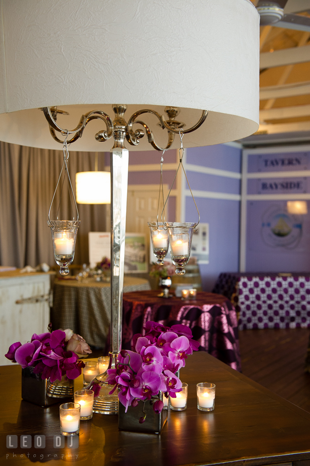 Large table lamp with hanging candles and purple orchids. Kent Island Maryland Chesapeake Bay Beach Club Bow Ties and Bubbly wedding show photos at the Tavern Bayside, by wedding photographers of Leo Dj Photography. http://leodjphoto.com