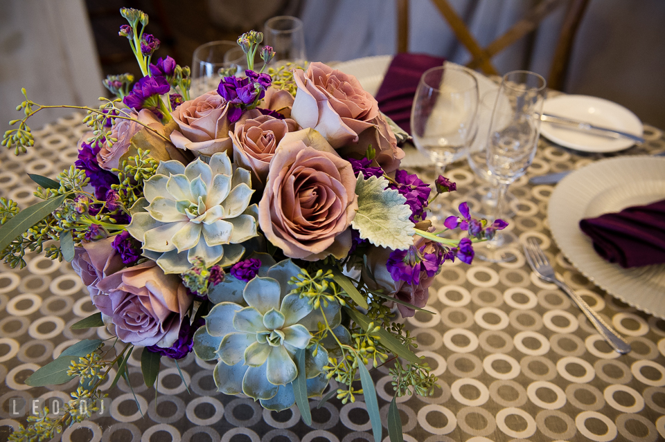 Succulents with pink salmon and violet roses table centerpiece from florist Wicked Willow. Kent Island Maryland Chesapeake Bay Beach Club Bow Ties and Bubbly wedding show photos at the Tavern Bayside, by wedding photographers of Leo Dj Photography. http://leodjphoto.com