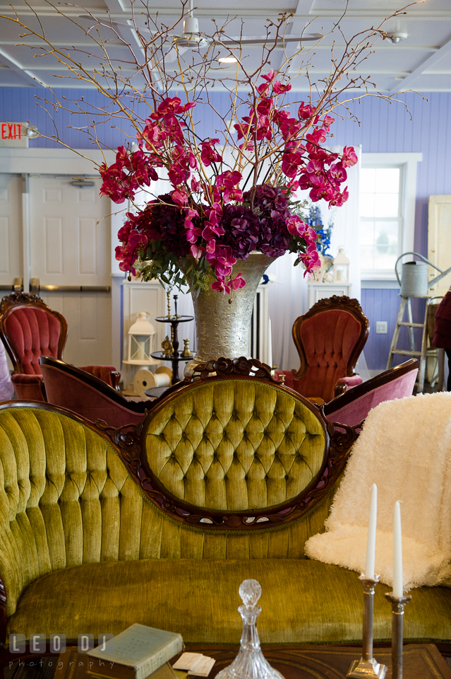 Yellow couch from Vintage Affairs and red orchids from florist Wicked Willow. Kent Island Maryland Chesapeake Bay Beach Club Bow Ties and Bubbly wedding show photos at the Tavern Bayside, by wedding photographers of Leo Dj Photography. http://leodjphoto.com