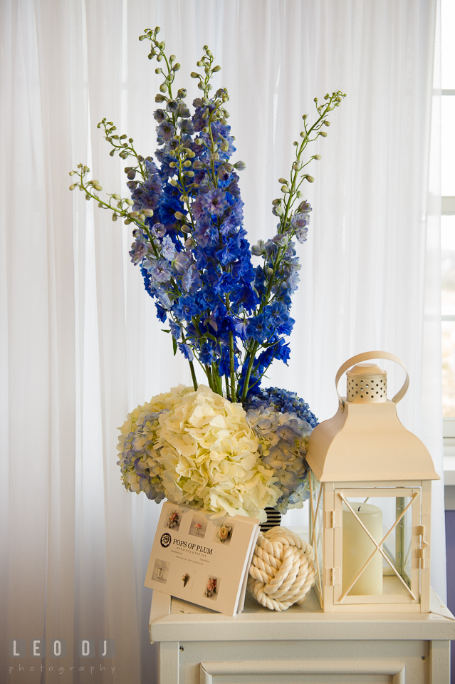 Blue flowers from Pops of Plum with nautical knot and lantern. Kent Island Maryland Chesapeake Bay Beach Club Bow Ties and Bubbly wedding show photos at the Tavern Bayside, by wedding photographers of Leo Dj Photography. http://leodjphoto.com