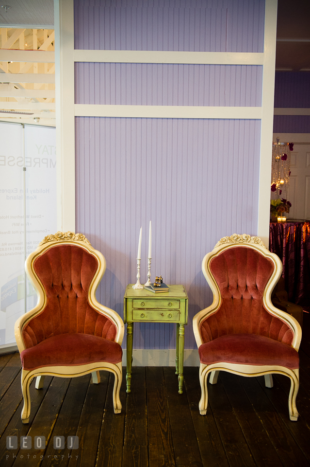 Old red chairs and side table from Vintage Affairs. Kent Island Maryland Chesapeake Bay Beach Club Bow Ties and Bubbly wedding show photos at the Tavern Bayside, by wedding photographers of Leo Dj Photography. http://leodjphoto.com