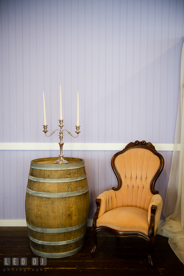 Light brown old chair and candle holder from Vintage Affairs. Kent Island Maryland Chesapeake Bay Beach Club Bow Ties and Bubbly wedding show photos at the Tavern Bayside, by wedding photographers of Leo Dj Photography. http://leodjphoto.com