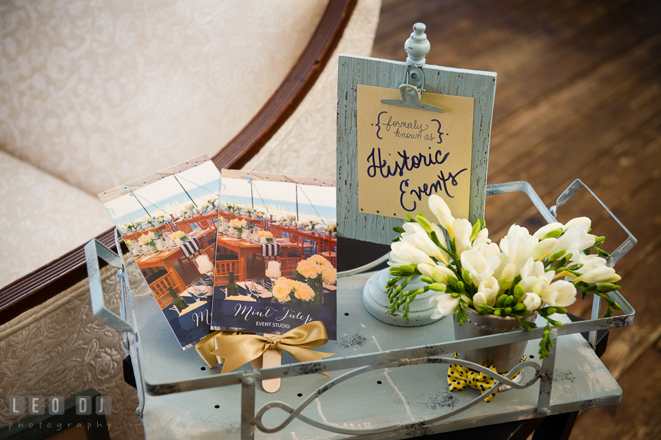 Small cart with flower and signs from Mint Julep, Historic Events Wedding and Event Planning. Kent Island Maryland Chesapeake Bay Beach Club Bow Ties and Bubbly wedding show photos at the Tavern Bayside, by wedding photographers of Leo Dj Photography. http://leodjphoto.com